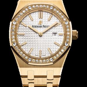 Reloj Audemars Piguet Royal Oak Cuarzo en oro amarillo 18k. Esfera Gran Tapicería color plateado e indicación de fecha.